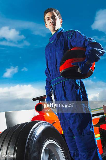 Racecar Driver Holding Helmet