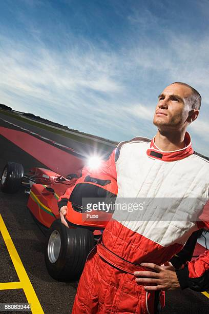 racecar driver holding helmet - will power race car driver stock pictures, royalty-free photos & images