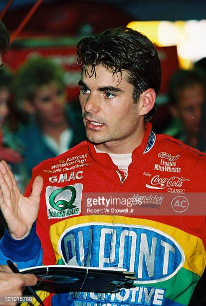 Racecar driver Jeff Gordon talks to his crew chief prior to qualifying for a Winston Cup race, at the Charlotte Motor Speedway, in Charlotte, North...