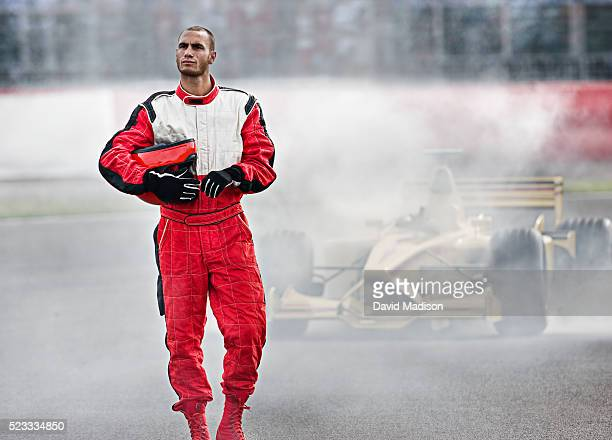 racecar driver leaving racecar with mechanical breakdown - race car driver stock pictures, royalty-free photos & images