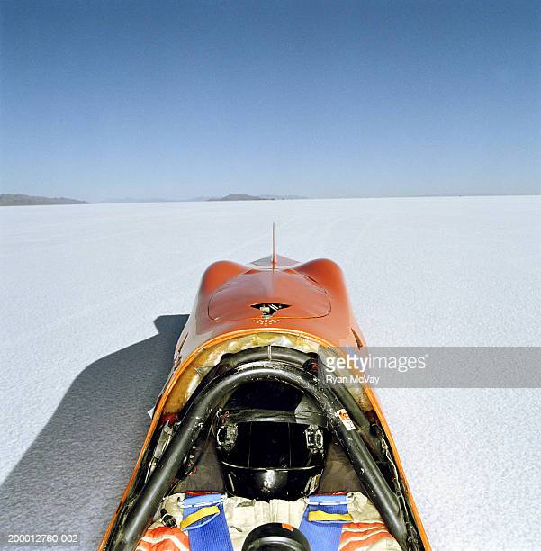 Racecar driver lying in streamliner car, elevated view, Utah, USA