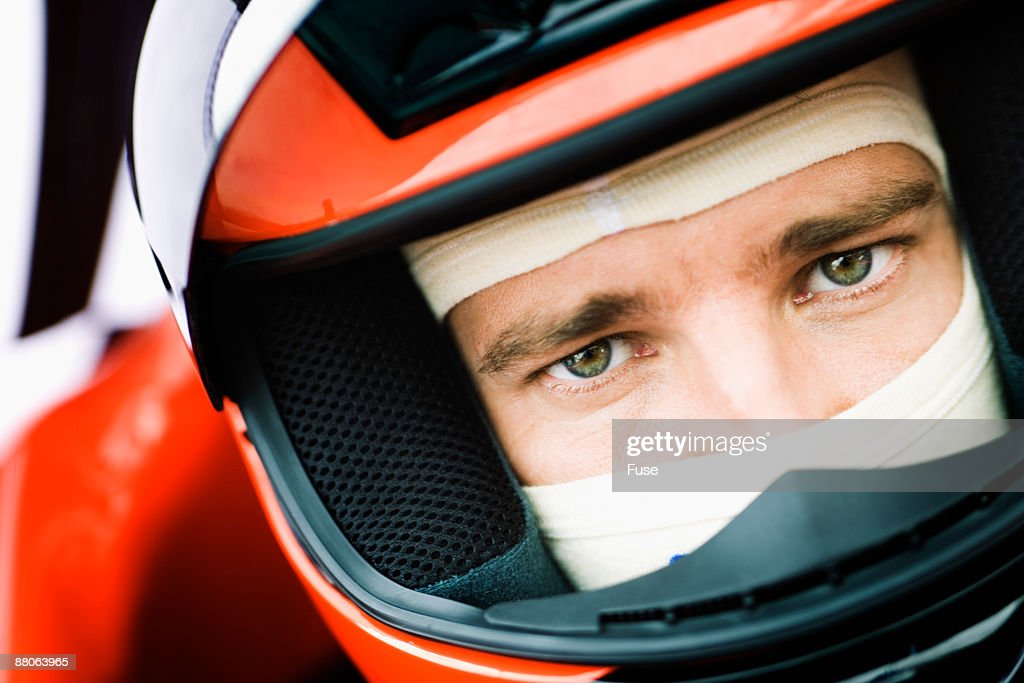 Racecar Driver Preparing for a Race : Stock Photo