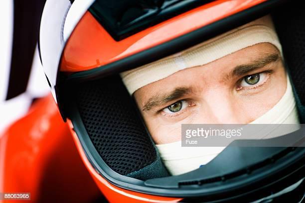 Racecar Driver Preparing for a Race