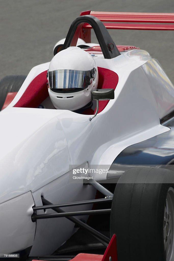 Racecar driver sitting in a racecar : Foto de stock