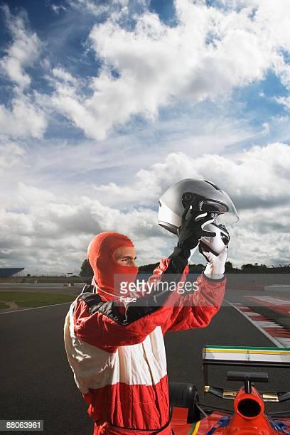 Racecar Driver Taking Off Helmet
