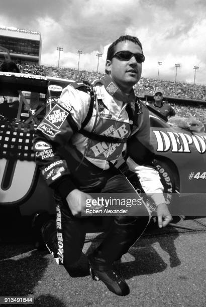 NASCAR racecar driver Tony Stewart prepares to enter his car prior to the start of the 2003 Daytona 500 stock car race at Daytona International...
