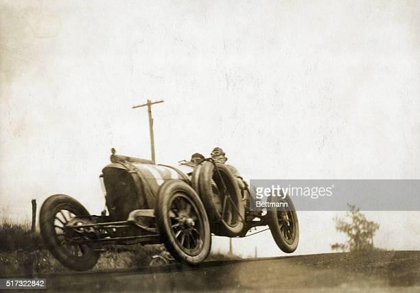 Racecar drivers Eddie Rickenbacker and Pete Henderson drive their Mason racecar along a rural road during the 1914 Elgin Road Race in Elgin Scotland