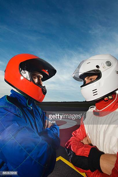racecar drivers standing face to face - race car driver stock pictures, royalty-free photos & images