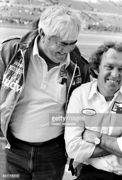 NASCAR racecar owner and former driver Junior Johnson tallks with a member of his racing team prior to the 1983 Daytona 500 stock car race at Daytona...