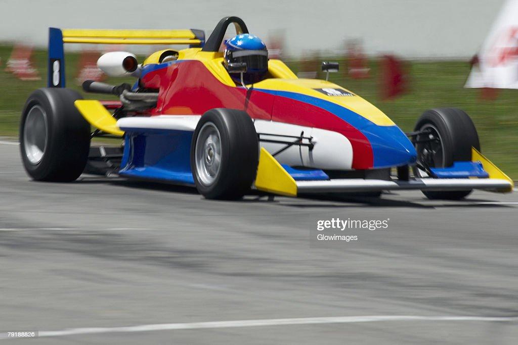 Racecar racing on a motor racing track : Foto de stock