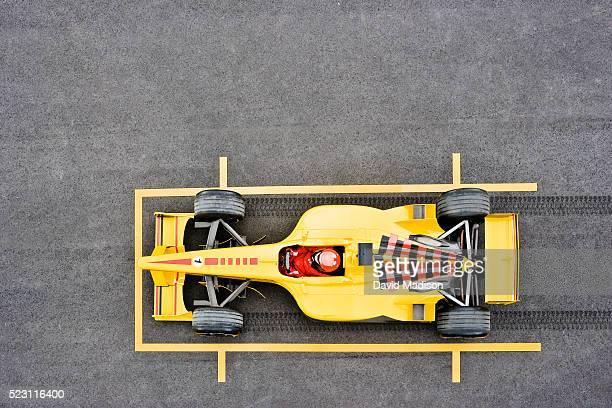 Racecar Skidding into Position on Grid