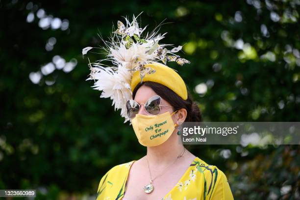 Race-goer Anna Gilder poses for photographers as she enters the grounds at Ascot Racecourse on June 15, 2021 in Ascot, England. 12,000 spectators are...