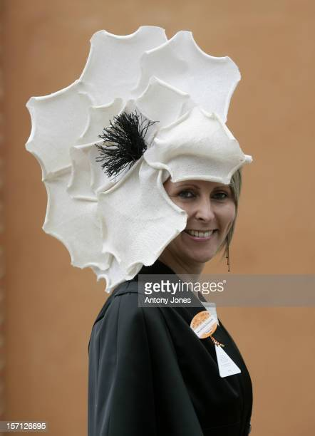A Racegoer Arrives For The Second Day At Ascot Racecourse Berkshire