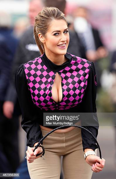 A racegoer attends day 1 of the Crabbie's Grand National horse racing meet at Aintree Racecourse on April 3 2014 in Liverpool England