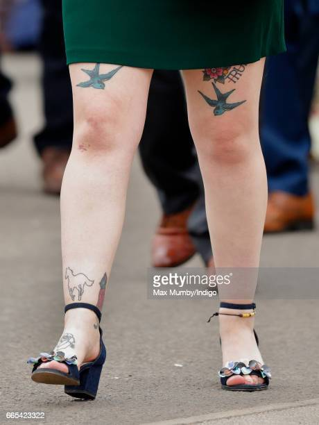 A racegoer attends day 1 of the Randox Health Grand National Festival at Aintree Racecourse on April 6 2017 in Liverpool England
