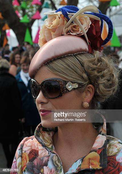 A racegoer attends Day 2 Ladies Day of the Aintree Races at Aintree Racecourse on April 4 2014 in Liverpool England