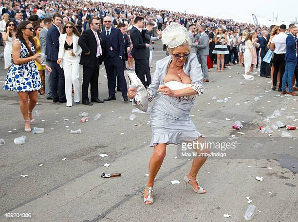 Racegoer attends day 2 'Ladies Day' of the Crabbie's Grand National Festival at Aintree Racecourse on April 10, 2015 in Liverpool, England.