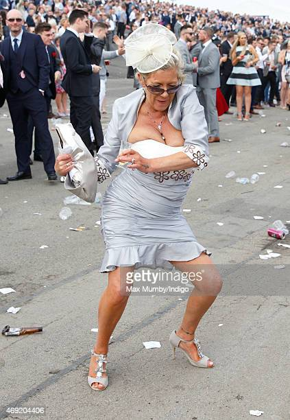 A racegoer attends day 2 'Ladies Day' of the Crabbie's Grand National Festival at Aintree Racecourse on April 10 2015 in Liverpool England