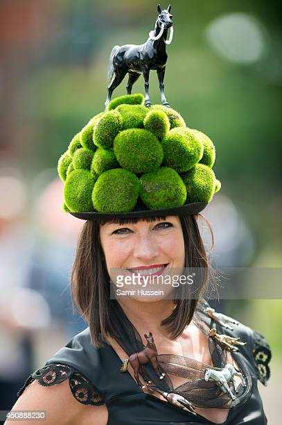 A racegoer attends Day 3 of Royal Ascot at Ascot Racecourse on June 19 2014 in Ascot England