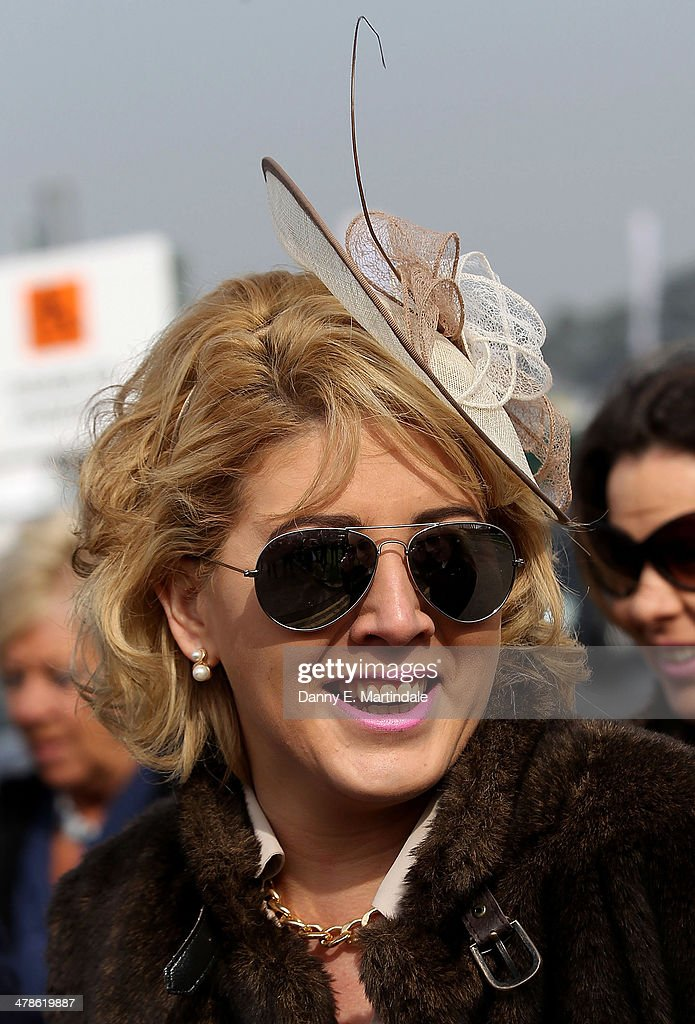 A racegoer attends day 4 of The Cheltenham Festival at Cheltenham Racecourse on March 14, 2014 in Cheltenham, England.