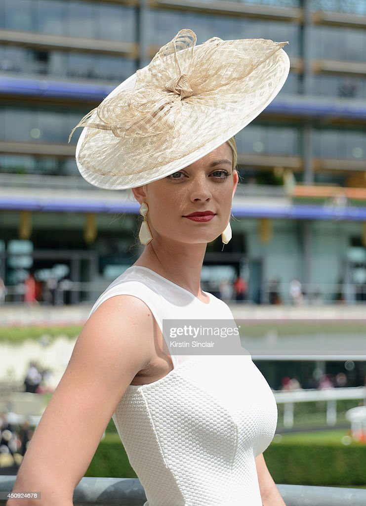 A racegoer attends day four of Royal Ascot 2014 at Ascot Racecourse on June 20, 2014 in Ascot, England.