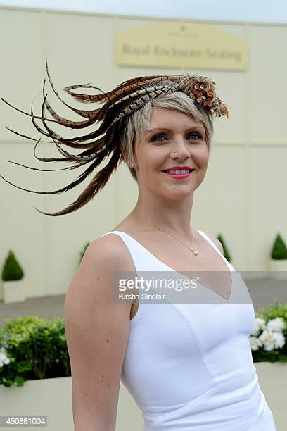 A racegoer attends day three of Royal Ascot at Ascot Racecourse on June 19 2014 in Ascot England