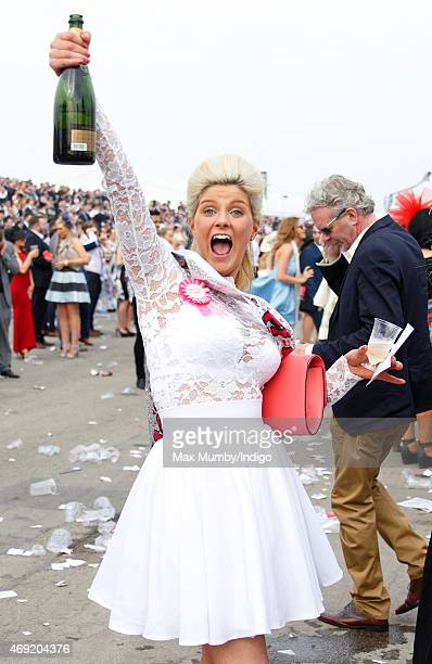 Racegoer celebrates as she attends day 2 'Ladies Day' of the Crabbie's Grand National Festival at Aintree Racecourse on April 10, 2015 in Liverpool,...