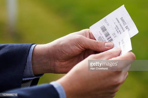 A racegoer checks out his winning betting ticket at Goodwood Racecourse on September 4 2018 in Chichester United Kingdom