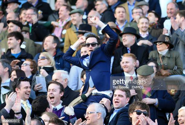A racegoer cheers on his horse in the Trull House Stud Mares' Novices' Hurdle during St Patrick's Thursday at the 2016 Cheltenham Festival at...