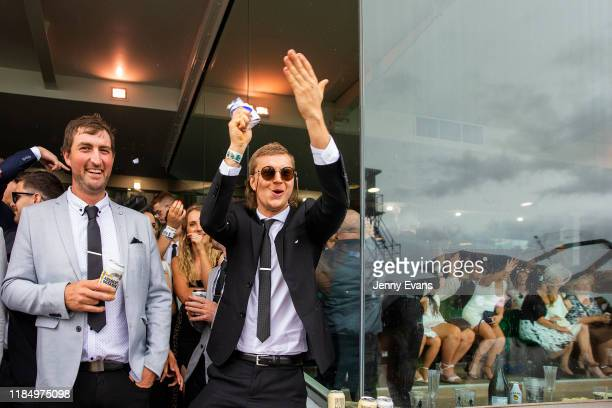A racegoer cheers on the horses during 2019 Derby Day at Flemington Racecourse on November 2 2019 in Melbourne Australia