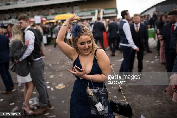 Racegoer dances after racing on Ladies Day, the second day of the Grand National Festival horse race meeting at Aintree Racecourse in Liverpool,...
