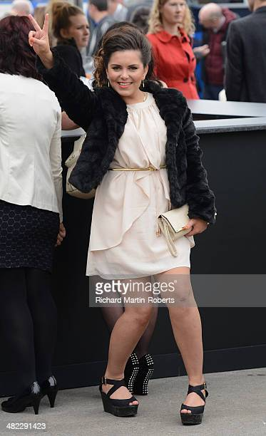 A racegoer enjoys the atmosphere during Day 1 of the Aintree races at Aintree Racecourse on April 3 2014 in Liverpool England