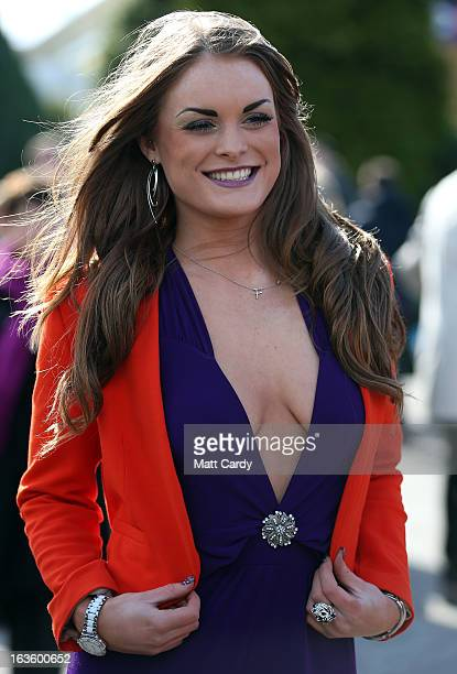 Racegoer Fawn Beddows poses for a photograph as she arrives for Ladies Day at Cheltenham Racecourse on the second day of the Cheltenham Festival 2013...