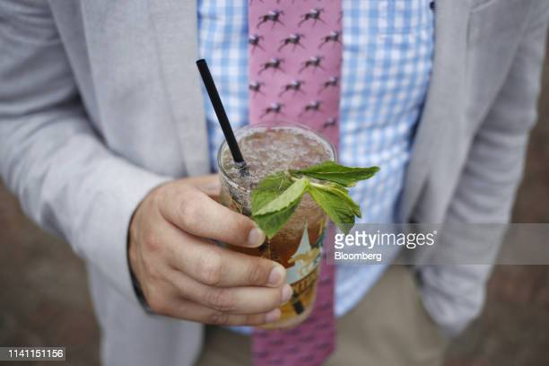 A racegoer holds a mint julep cocktail before the 145th running of the Kentucky Derby at Churchill Downs in Louisville Kentucky US on Saturday May 4...
