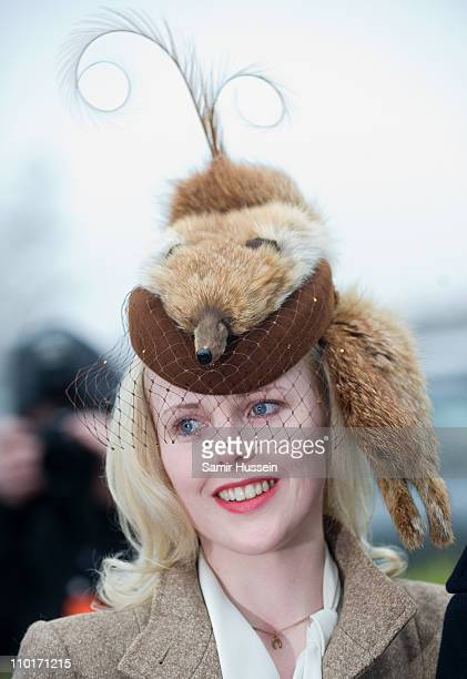 A racegoer in a fox hat attends Ladies Day of the Cheltenham Festival at Cheltenham Racecourse on March 16 2011 in Cheltenham England