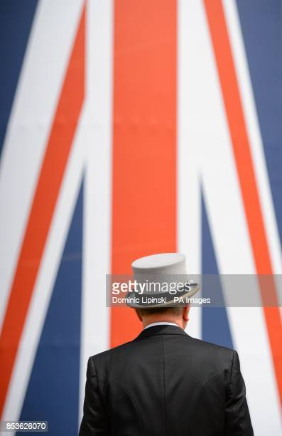 A racegoer in a morning suit arrives for the start of racing on Day Four of the 2014 Royal Ascot Meeting at Ascot Racecourse Berkshire