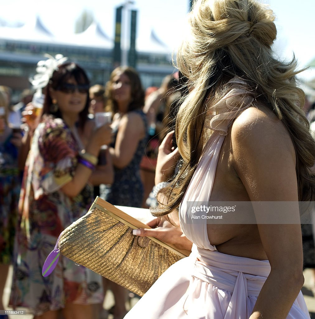 A racegoer is seen on Ladies Day at Aintree racecourse on April 08, 2011 in Liverpool, England .