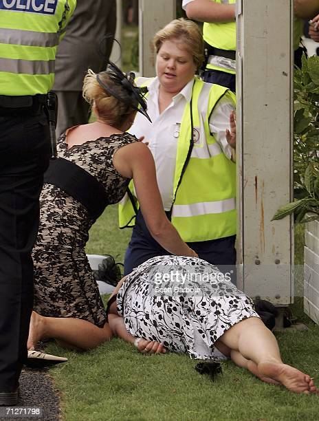 Race-goer is tended to by paramedics at Ladies' Day, the third day of Royal Ascot at the Ascot Racecourse on June 22, 2006 in Berkshire, England. The...