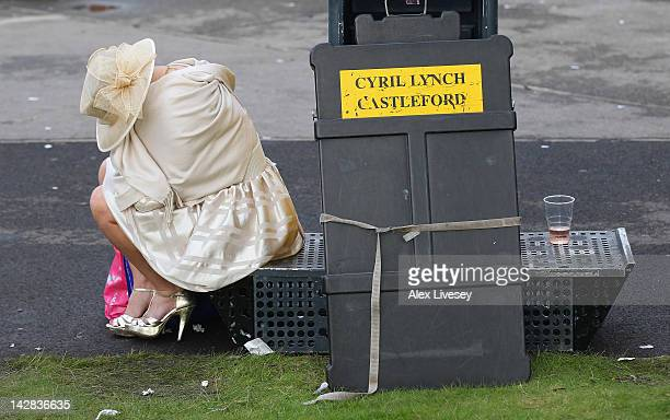 A racegoer looks worse for wear after Ladies' Day at Aintree Racecourse on April 13 2012 in Liverpool England