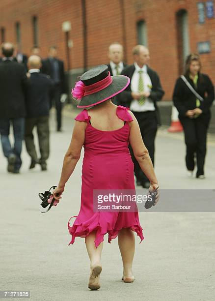 A racegoer makes her way home after Ladies' Day the third day of Royal Ascot at the Ascot Racecourse on June 22 2006 in Berkshire England The event...