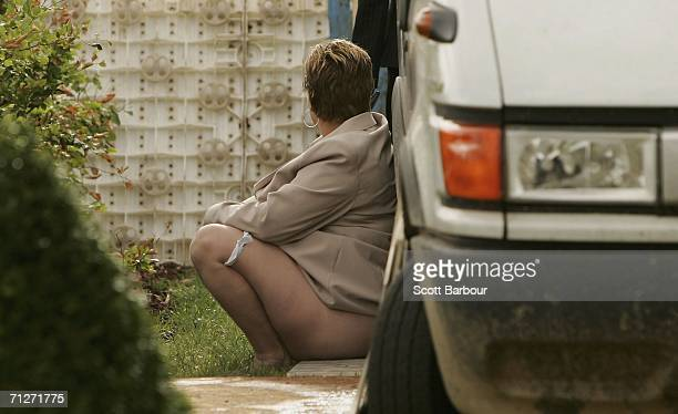 Race-goer pauses behind a truck as she makes her way home after Ladies' Day, the third day of Royal Ascot at the Ascot Racecourse on June 22, 2006 in...