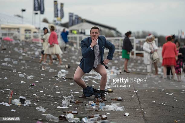 A racegoer poses as he prepares to leave Ladies Day the second day of the Grand National Festival horse race meeting at Aintree Racecourse in...