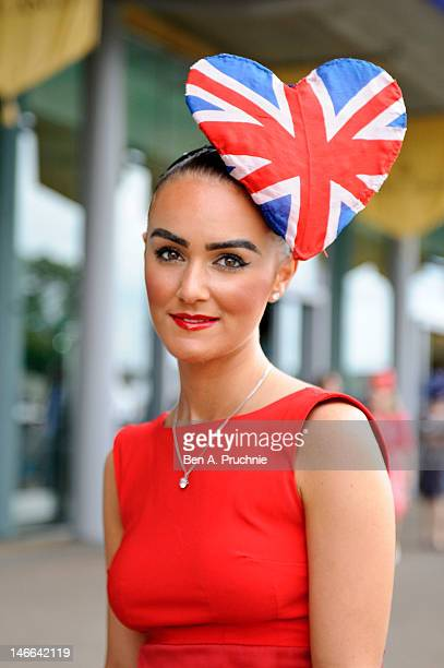 A racegoer poses during Ladies Day on day three of Royal Ascot at Ascot Racecourse on June 21 2012 in Ascot England