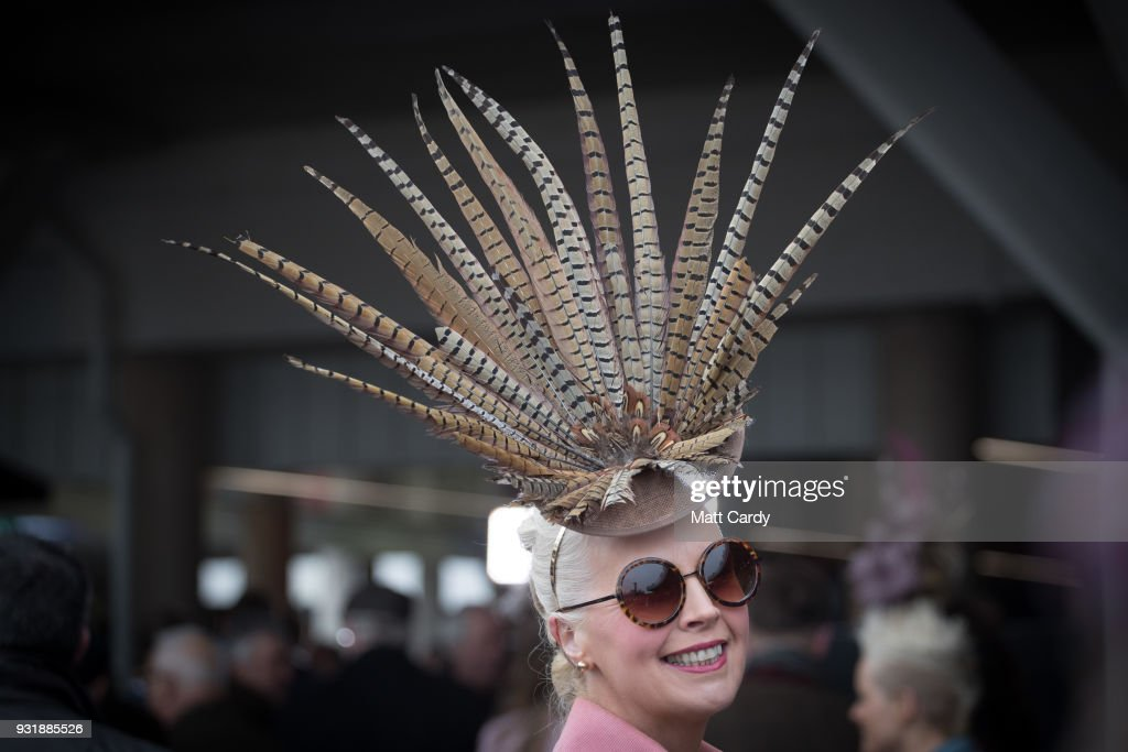 A racegoer poses for a photograph as she arrives for Ladies Day at Cheltenham Racecourse on March 14, 2018 in Cheltenham, England. Thousands of racing enthusiasts are expected at the four-day festival in Gloucestershire which opened yesterday.