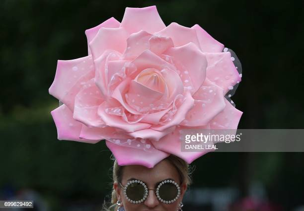 TOPSHOT A racegoer poses for a photograph as she attends Ladies Day at the Royal Ascot horse racing meet in Ascot west of London on June 22 2017 The...