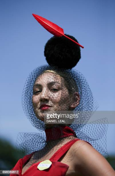 A racegoer poses for a photograph as they arrive on day one of the Royal Ascot horse racing meet in Ascot west of London on June 20 2017 The fiveday...