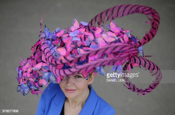 TOPSHOT A racegoer poses for a photograph on day one of the Royal Ascot horse racing meet in Ascot west of London on June 19 2018 The fiveday meeting...