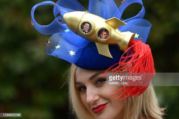 Racegoer poses for a picture wearing an Elon Musk-inspired hat as she arrives to attend Ladies Day at the Royal Ascot horse racing meet, in Ascot,...