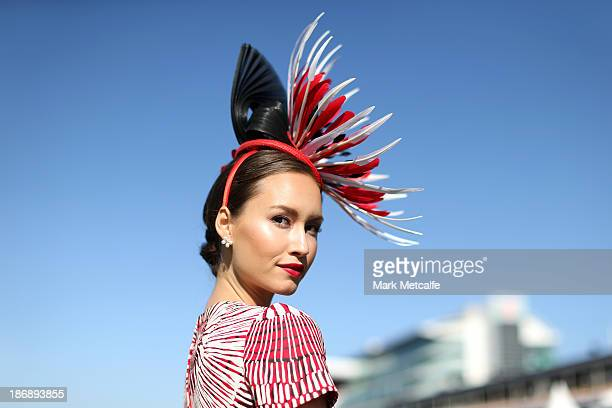 A racegoer poses for a portrait during Melbourne Cup Day at Flemington Racecourse on November 5 2013 in Melbourne Australia