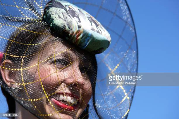 A racegoer poses for photo during Melbourne Cup Day at Flemington Racecourse on November 5 2013 in Melbourne Australia